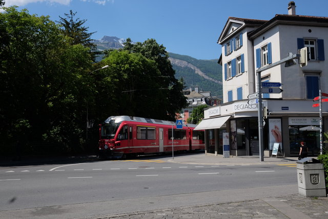 Train to Arosa running through Chur city streets