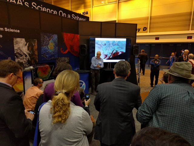 Eric Stevens presenting at the NOAA booth