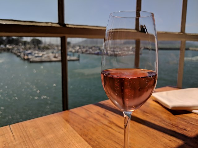 Wine glass at Green's overlooking the Marina