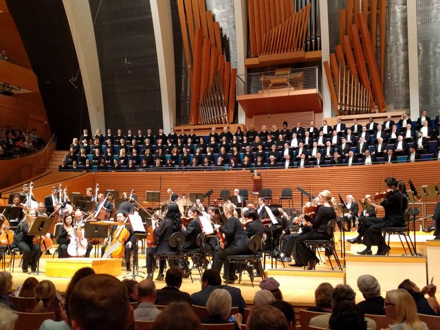 The symphony orchestra and chorus in Helzberg Hall