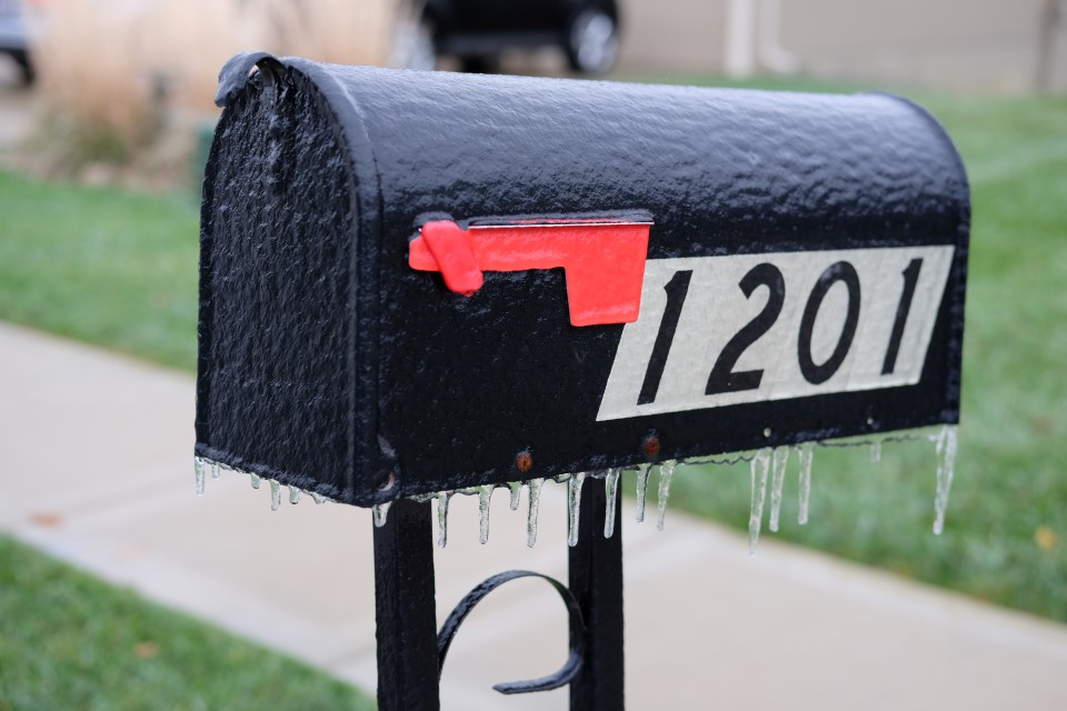 Ice covered mailbox after freezing rain